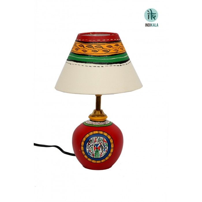 Terracota Red Lamp with Cream Shade This unique terracotta round matki lamp has been beautifully handpainted to add the requried mood to the room. The shade has also been handpainted keeping in mind the color coordination with the earthen lamp.http://www.indikala.com/featured-products/terracota-red-lamp-with-cream-shade.html