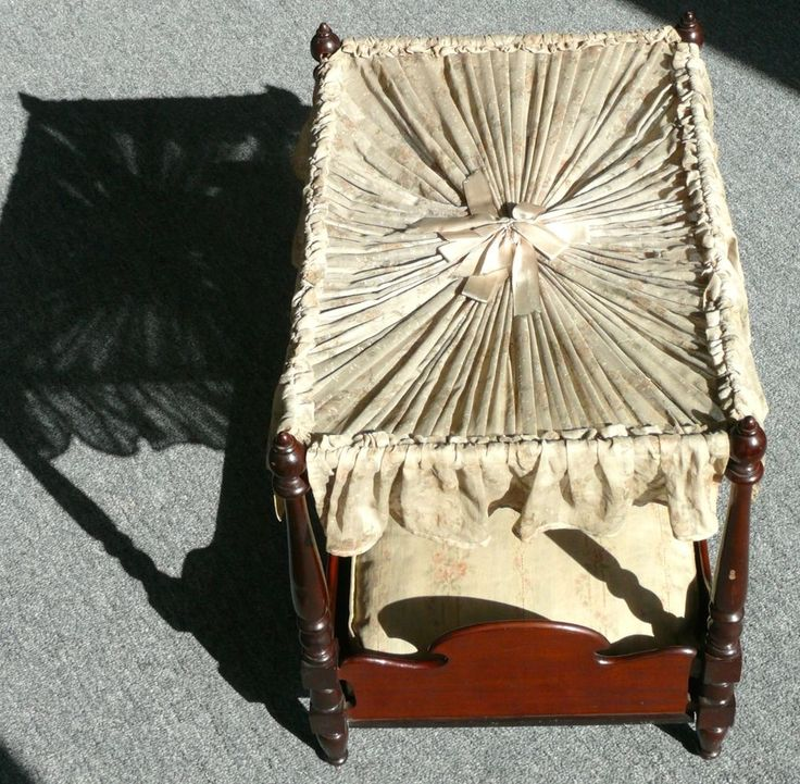VICTORIAN FOUR POST DOLL BED WITH PERIOD MATTRESS AND COVER 1900'S