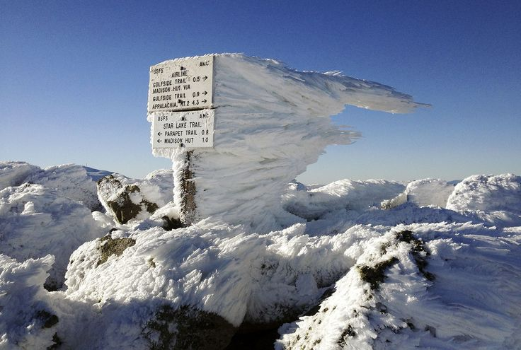 #Rimeice extends several feet horizontally from a sign marking the summit of 5,774-foot #MountAdams, the second highest mountain in #NewEngland, in northern #NewHampshire. Monday's freezing fog and strong winds formed the rime ice, creating a #winter wonderland above the treeline in New Hampshire's aptly named #WhiteMountains.
