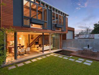 Nick Bell Design. Rear facade, garden, pavers, steel shutters. Nelson Street Annandale