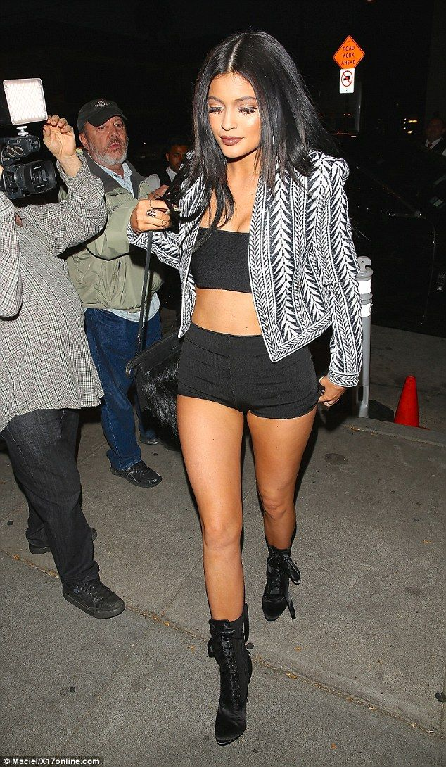 Inappropriate? Kylie Jenner wore a black bandeau and shorts when she was seen arriving for...