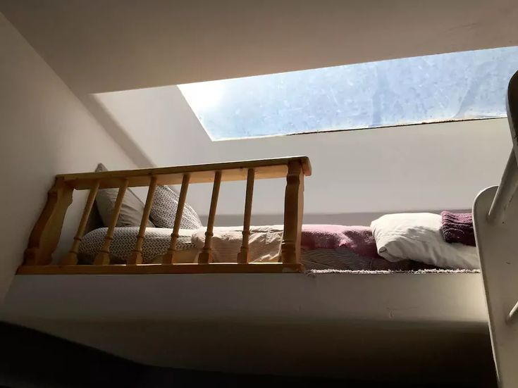 single loft bed above sun room, Visit Santa Fe, rent a cozy historic adobe home in town, good winter rates, walking distance to the plaza, check it out Airbnb 2562597, Winter in New Mexico is beautiful for skiing, snow shoeing and hikes under the full moon.