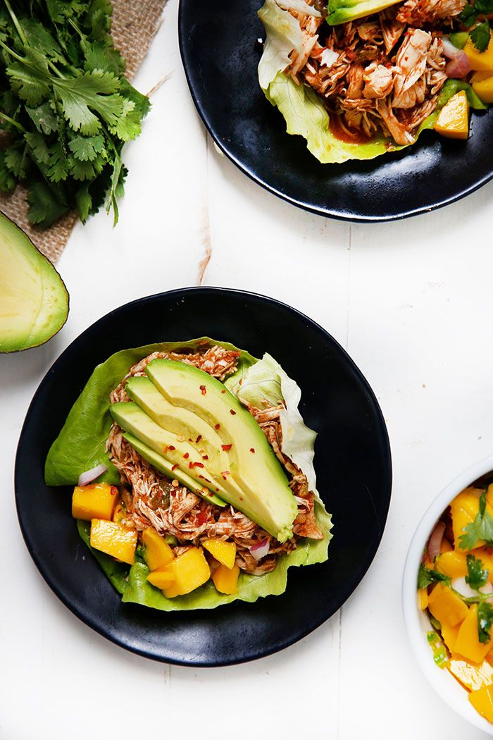 Delicious flavors come together in this slow cooker Caribbean Pulled Chicken, served as  lettuce wraps and topped with a simple fresh mango salsa! Make it a light, yet hearty meal by piling this flavorful chicken into your lettuce wraps, top with your favorite add-ons, and devouring! My blogging ladies are back at it with an …