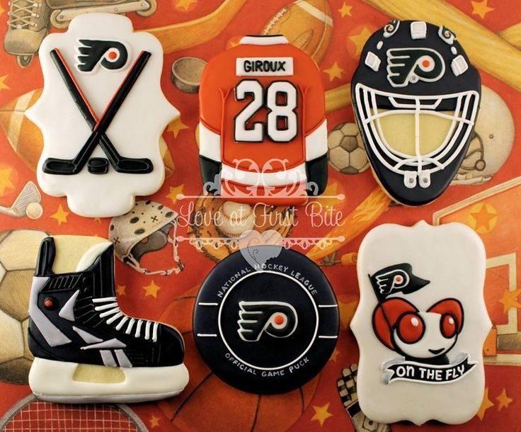 I'd pick a different team, but these Flyer cookies look amazing. The game puck one is awesome