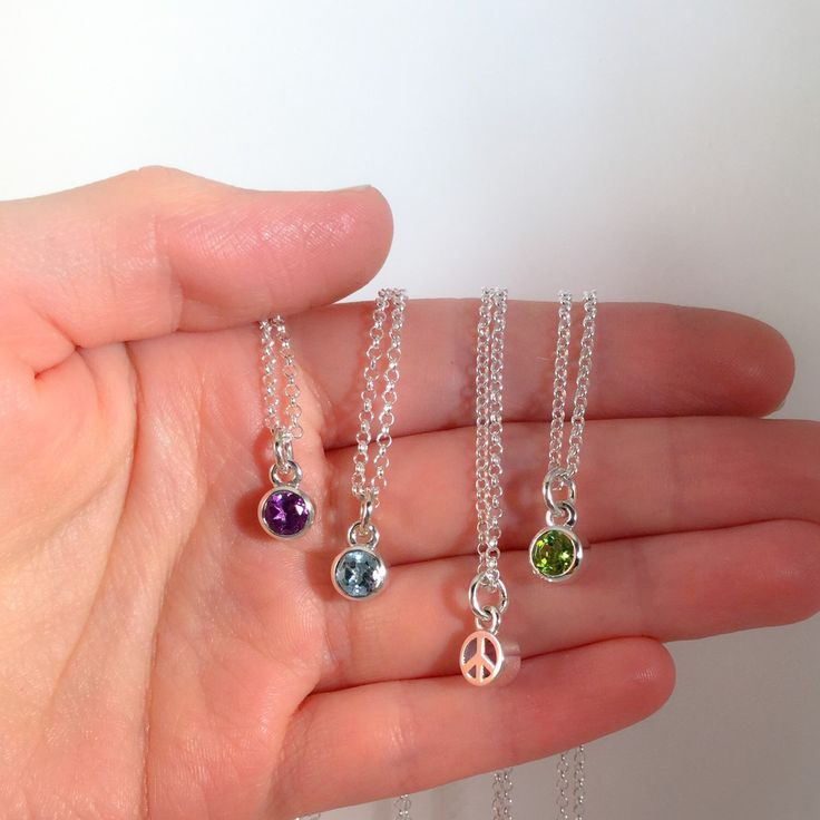 The Perfect Christmas gift! Peace Gem Necklaces.. Pretty gemstones in a peace sign setting.. ✌️x