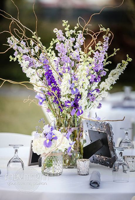 Brides: Purple and White Centerpiece with Larkspur Flowers. LarkspurLet's hear it for a flower that has a dual personality: It symbolizes both beautiful spirit and fickleness. Part of the buttercup family, larkspur is a complex flower like the orchid with an irregular shape. Featured In: Purple and White Centerpiece with Larkspur FlowersPhoto:  HA Photography