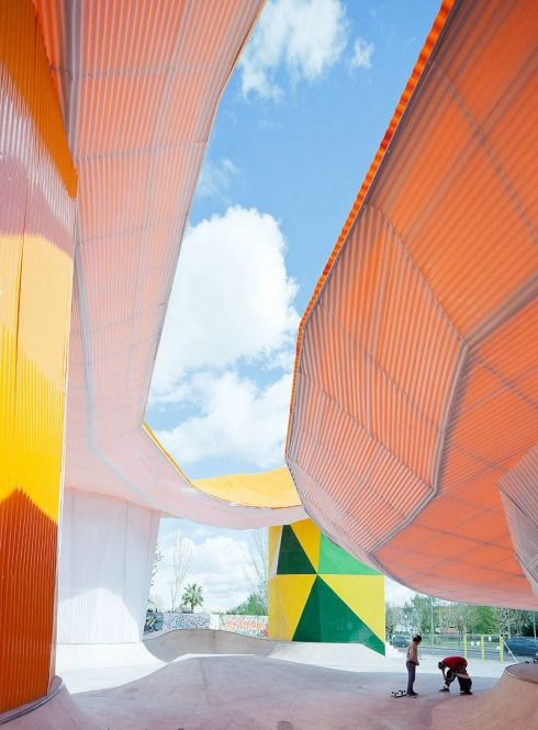 SelgasCano Architects' design for the new Youth Factory (Factoría Joven) in Mérida, Spain is all about welcoming and protecting. The colorful youth center is very open with its, possibly, most notable feature being a huge orange, organically shaped canopy that protects from rain and the strong hot rays of the sun, typical of Mérida. The architects refer to this prominent aspect as a plastic 'cloud'.
