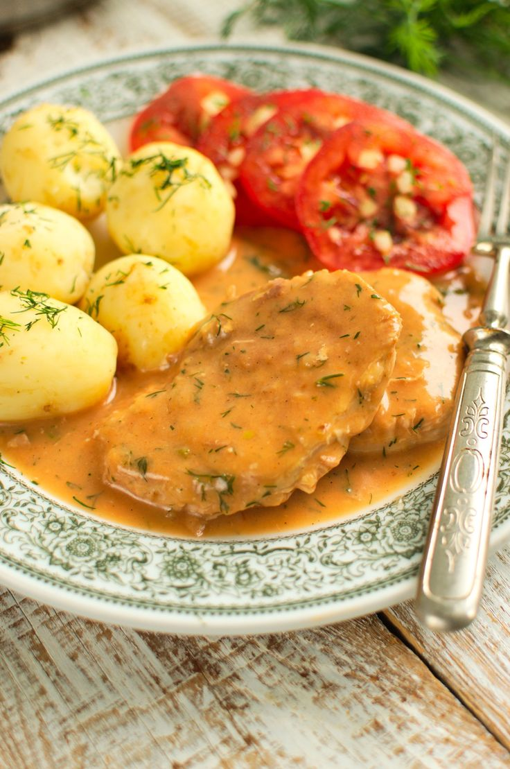 Schnitzel with ham in tomato and dill sauce