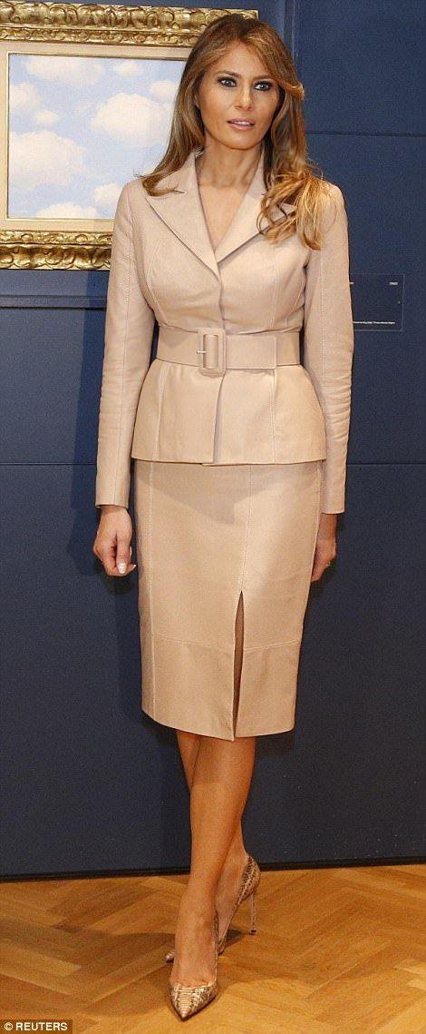 Melania looked elegant in a tan skirt suit and Manolo Blahnik snakeskin heels, the same ou...