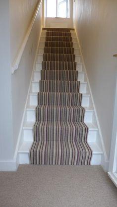neutral striped carpet with purple pinstripe