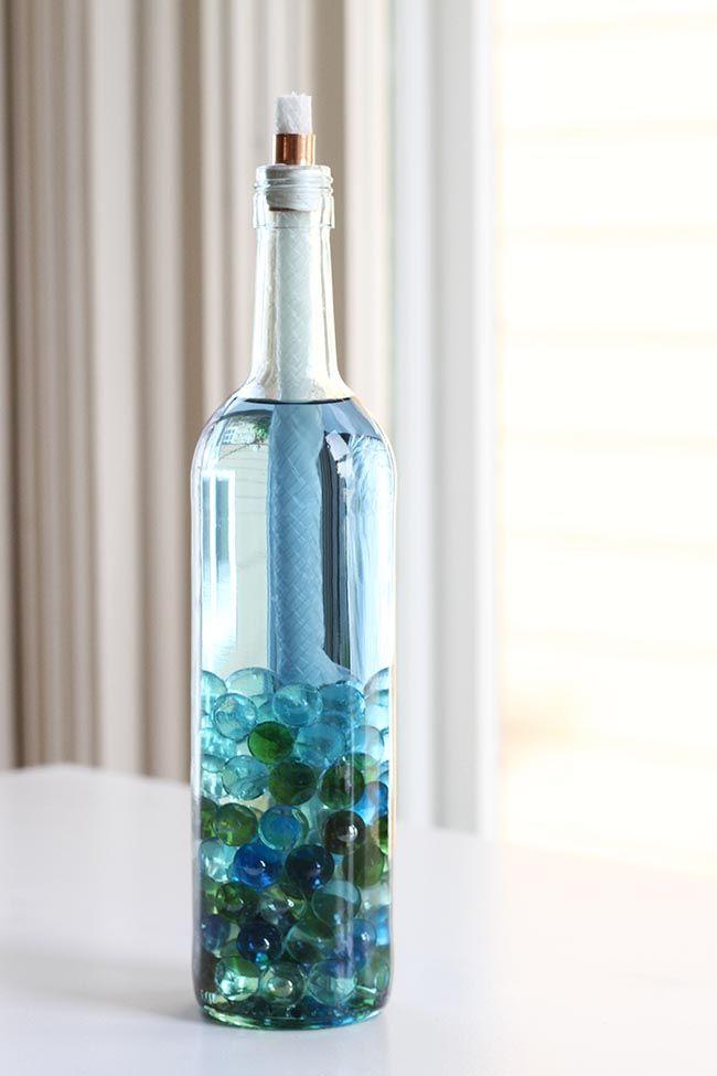 DIY: Wine Bottle Citronella Candles | http://helloglow.co/diy-wine-bottle-citronella-candles/