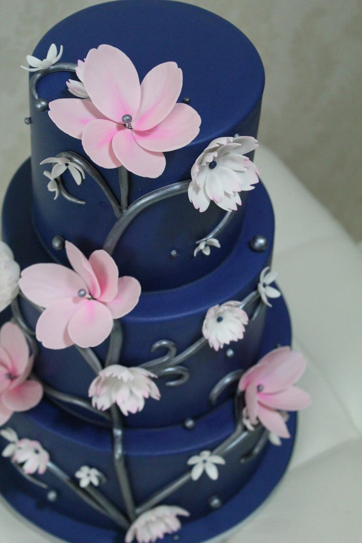 Modern Navy Blue Wedding cake with Pale pink and White Flowers with Silver Swirls