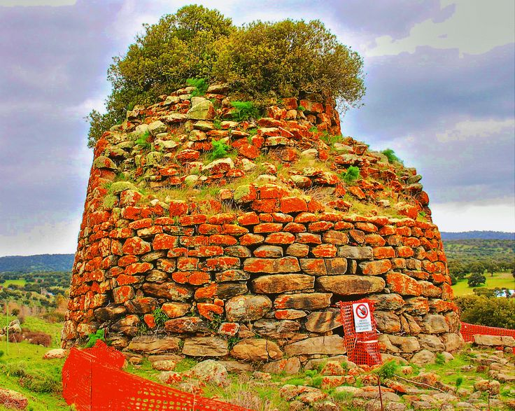 The so called Nuraghe 'Ola' terms which is strongly connected with Butterflies...represents the symbol of the village of Oniferi..it is surrounded by Sardinian houses... by loybillyrock