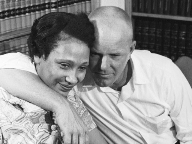interracial couples from the old days | Married couple Mildred and Richard Loving embrace at a press ...