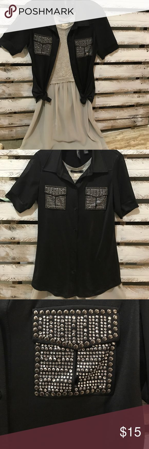 """BKE Boutique Button Down Metallic Tee SMALL 👚 Black metallic button down with chiffon sleeves and embellished pockets on chest.  Left pocket is missing approximately 4 rhinestones. Silky and stretchy material.  Can wear open as a cardigan and tie up the bottoms as pictured it wear as a classy Top buttoned down.  Cute over a flowy dress for an extra """"wow"""" factor!  Spice things up with this incredible shirt! BKE Tops Button Down Shirts"""