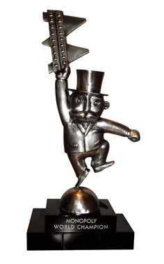 """The """"Monopoly World Championship"""" custom award is based on the Monopoly """"Tycoon"""" character that is featured on Monopoly properties. The custom awards design stands 2 feet tall, and is produced in pewter. The custom award is mounted on a black marble base engraved with """"Monopoly World Champion"""" and the name of the winner."""