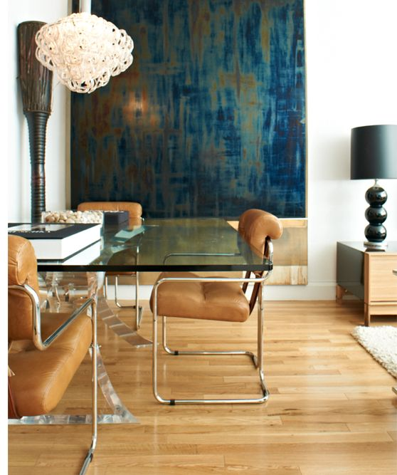 The Balance Of Rich Dark Blue And Turquoise On Abstract Art Piece With Caramel Leather Chairs Smoked Glass Table Is Perfect