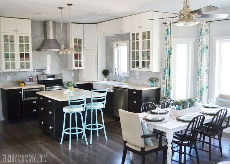 A Beautiful Vintage Industrial Kitchen Featuring Black And White Ikea Cabinets Turquoise Accents And A