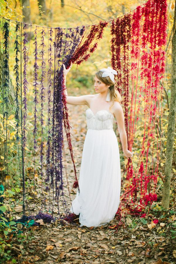 Except with hanging flowers! // Inspired: a knotted yarn backdrop.