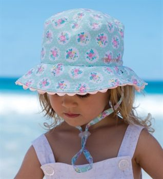 This hat it the perfect baby girl's beach hat. It is made from super soft microfibre which dries fast when wet. It is fully reversible, 2 styles in one hat.