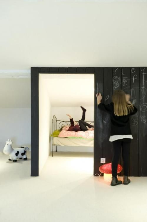 kids room in gables. create niche with planks of wood and chalkboard paint.