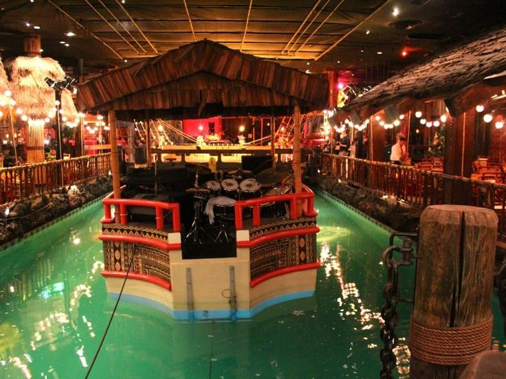 19 The Tonga Room  The height of faux-Polynesian kitsch, the Fairmont Hotel's basement bar can be counted on for rum-heavy drinks served inside pineapples, pu-pu platters, and rain shows every half hour in the central pool, complete with a live band playing oldies on a floating barge. Long may it reign.  25 Classic Restaurants Every San Franciscan Must Try - Eater SF