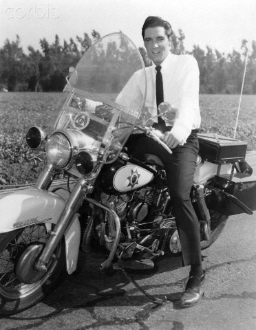 Elvis Presley on police motorcycle during movie It Happened at the World's Fair