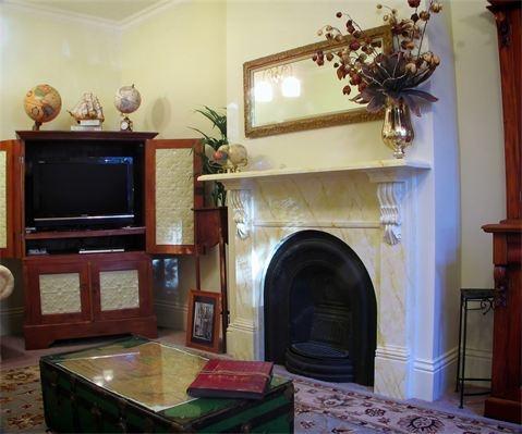 "Formal Lounge Room view 2 : comfortable seating and 32"" plasma TV"