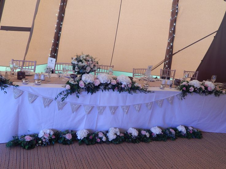 Top table with the church door archway re-used for the front