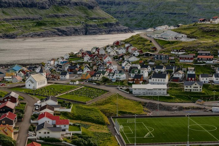 Looking down onto the picturesque village of Eidi at dusk on the island of Eysturoy in the Faroe Islands.