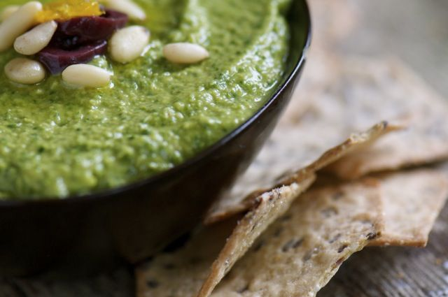 Green Monster Hummus  Ingredients    1 can chickpeas  ¼ cup tahini  1 teaspoon garlic powder  1 -2 tablespoons lemon juice  1 tablespoon Bragg  ½ cup water  ¼ cup olive oil  1 teaspoon salt  1 teaspoon oregano  1 teaspoon basil  2 cups spinach