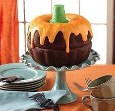 Yummy Halloween Cake...Just put 2 bundt cakes together, frost and use an ice cream cone for the stem.