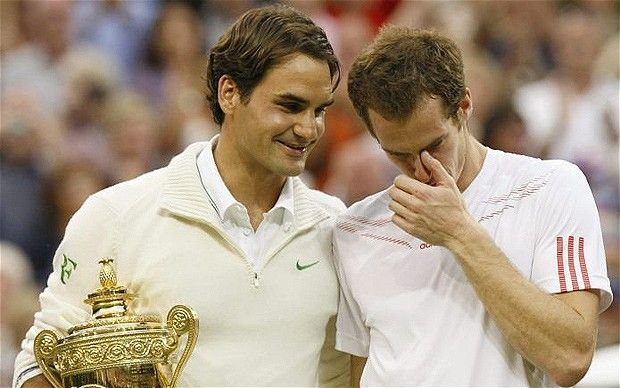 Emotional end to the men's singles final - Roger Federer holds his trophy and comforts Andy Murray.