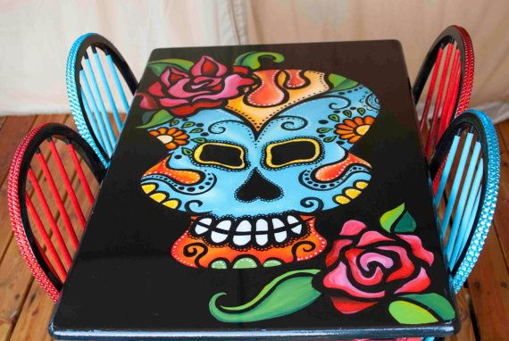 Day of The Dead dinette set.  Hand painted dias de los muertos dinning table with four chairs.  Colorful skull and rose on table top.