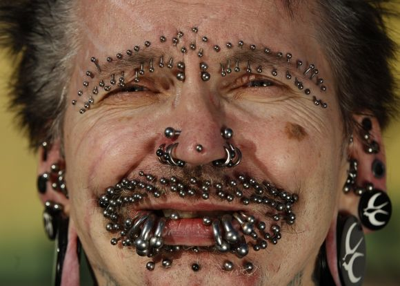 Guinness World Record holder for the 'Most Pierced Man', Rolf Bucholz of Germany, poses showing some of his 453 piercings in Dortmund,