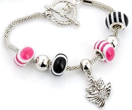SC120 Handmade silver charm bracelet, on snake chain, with owl charms and striped porcelain European beads. Normally retails for around $25 each - my selling price (including postage within Australia) is $15.00 each... Please feel free to contact me if your require price for postage overseas…