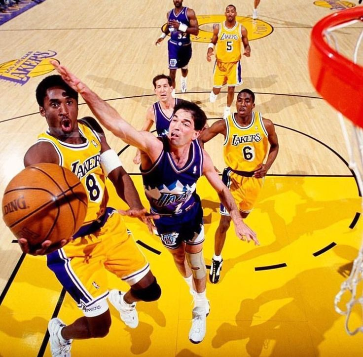 Kobe Bryant driving against the great Utah Jazz team finishing over one of the all time great defenders John Stockton