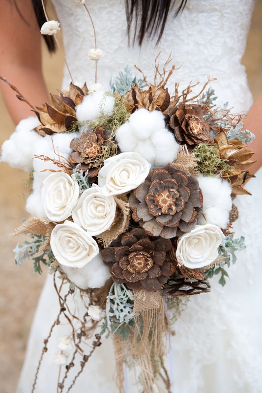 Pinecones and cotton are perfect picks for a unique fall or winter wedding bouquet. Photo by Michael Radford