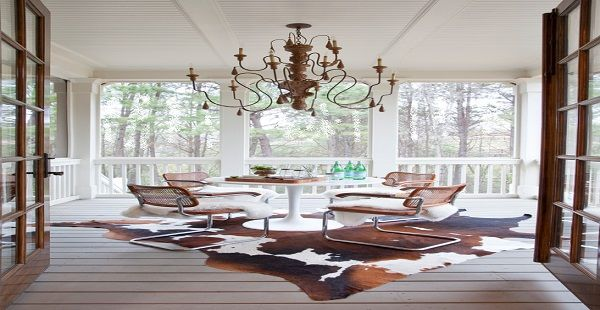 Beautiful Porch with Outdoor Chandelier and Cow Rug