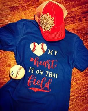 "Shop now..Proudly support your baseball or softball player in this super cute glitter design ""My Heart Is on That Field"" raglan tee. Customized to your team's color scheme , this super soft raglan tee will surely be a favorite because it's cute AND comfortable. Perfect for moms, grandmas, aunts, GFs and wives. These are unisex in size, and run true. Please put color scheme details in the required field and be as specific as you can using terms like royal blue or navy blue and vegas gold or…"
