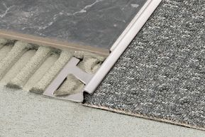 Schluter-RENO-TK - Transition from tile to floor coverings at lower elevations, such as carpet.