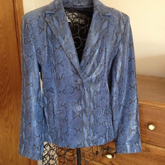 """Wilsons long sleeve Blue Jacket with lining. Button up with pockets, snakeskin look design. Length is 23"""" , from collar to shoulder seam is 5 3/4"""". Sleeve length 24"""". Across front is 20"""". Across shoulders below collar is 17 1/2"""". Tag suggests dry clean only. Nice gently worn condition. Wilsons Leather Jackets & Coats"""