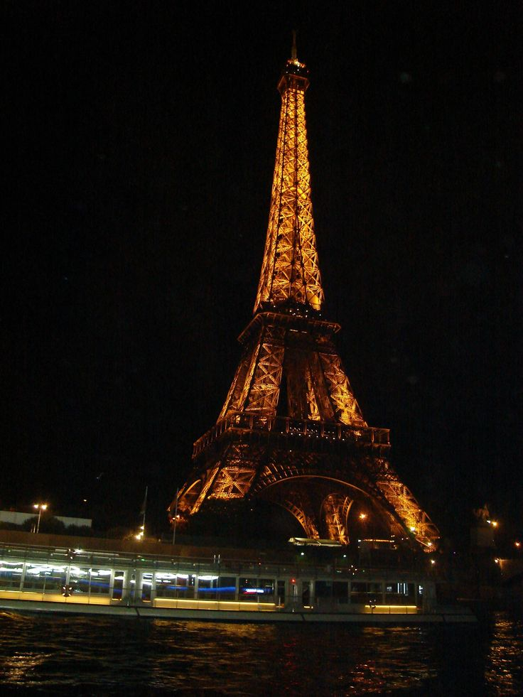 Eiffel Tower at night seen from the River Seine