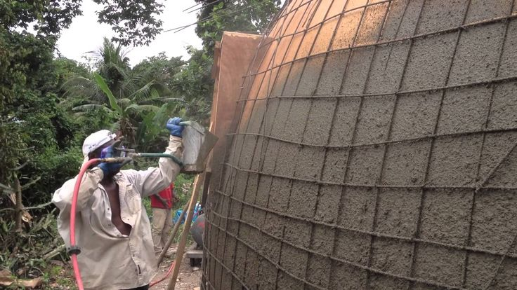 Monolithic Dome Construction with a Stucco Sprayer | Hildebrand Construction in Haiti - YouTube