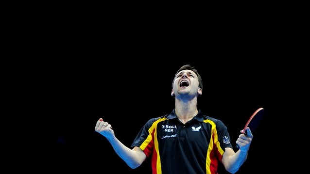 Timo Boll of Germany celebrates defeating Jiang Tianyiof Hong Kong, China and winning the men's Team Table Tennis bronze medal match on Day 12 of the London 2012 Olympic Games at ExCeL