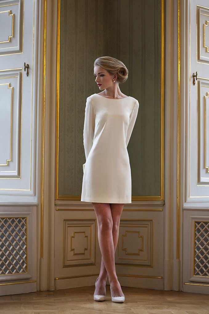 ALEXANDRINE short city hall wedding dress is perfect for brides who want to look modern but still feminine. Crafted from wool, this long sleeve figure-skimming design is embellished with an oversized bow - by ODYSAY