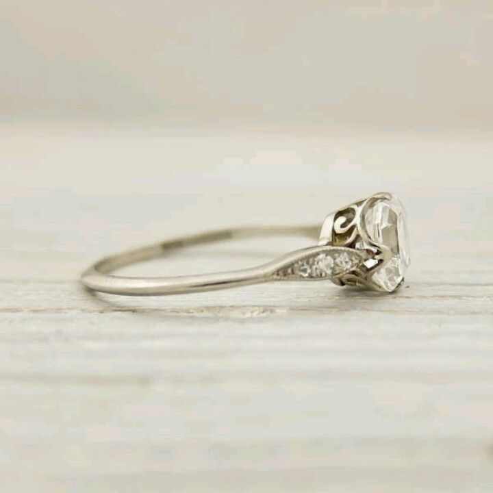 Tiffany's antique engagement ring- simple, thin band, somewhat small diamond. I love it. So simple and elegant. Not really the kinda girl who likes big rocks! This is my dream ring :)