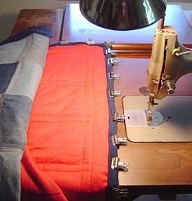Binding a denim quilt. Great idea for holding thick fabrics together while sewing!!!