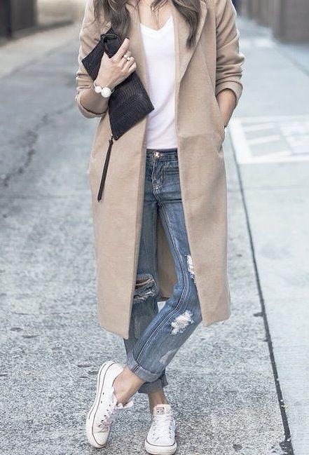 Long camel coat, boyfriend jeans, Converse sneakers, black clutch purse