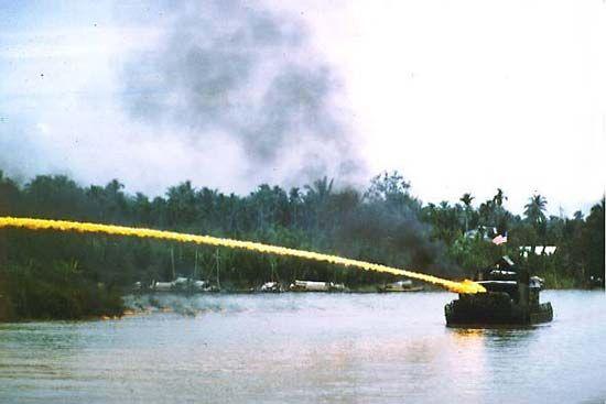 U.S. Navy patrol boat uses a napalm flamethrower ~ Vietnam War